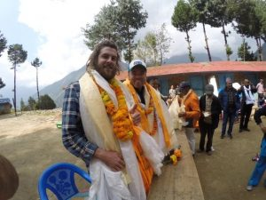 Brothers Hamish and Charlie at the opening ceremony. The scarfs are a traditional token of appreciation in the Buddha culture. This was only about 1/4 of them!