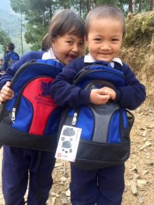 Brother and sister (Puster and Ester) receiving their own school bags. A last minute extra $5000 Ballarat Grammar grant that enabled equipment and furniture for the school. All 87 kids who attended the school (85 at the ceremony) received their own school bag filled with necessary equipment we take for granted.