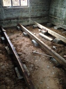 This photo shows works on the sub floor. Note the timber shavings on the ground to act as a moisture barrier.